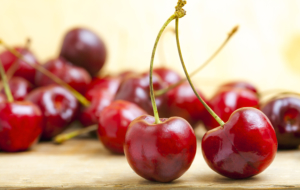 Fresh Red Cherries On A Wooden Table