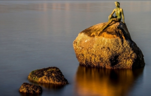 Girl In A Wetsuit Statue Background