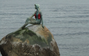 Girl In A Wetsuit Statue Photos