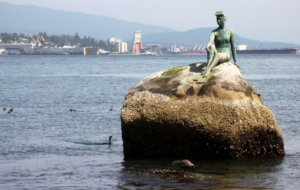 Pictures Of Girl In A Wetsuit Statue