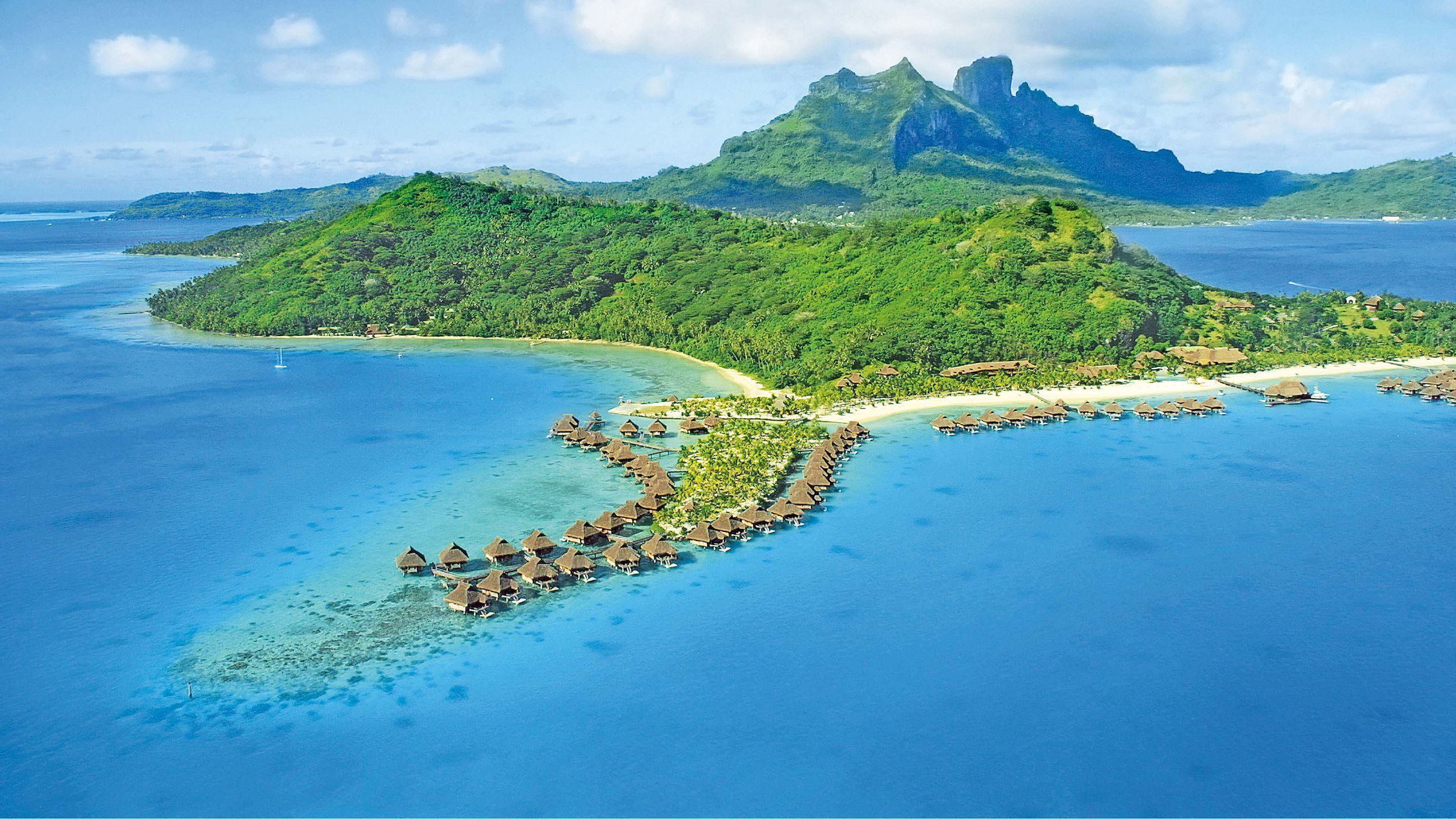 Aerial View Of Bora Bora With Mount Otemanu In Background And Coral Reef